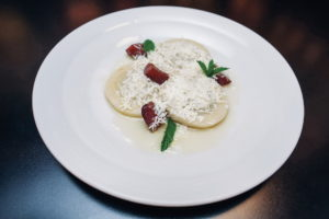 homemade potato gnocchi filled with plum jam, served with grated cottage cheese, melted butter and icing sugar