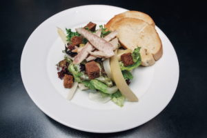 lettuce leaves with marinated Czech asparagus, rhubarb, pieces of smoked trout, brown bread croutons and warm crusty bread