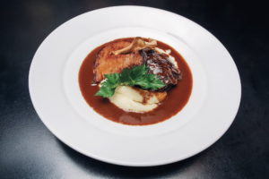 stewed veal neck with dark beer, onions and malt vinegar, served with mashed potatoes and turnip baked in coarse-grained salt
